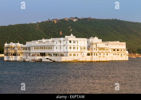 Taj Lake Palace Hotel on Lake Pichola in the late afternoon sunlight, Udaipur, Rajastan, India - Stock Photo