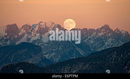 The full moon rising over the Kaiser Mountains, Tyrol, Austria - Stock Photo