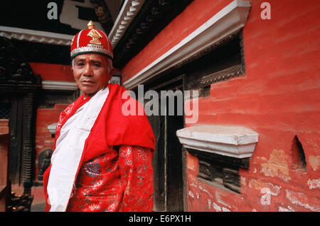 Newari priest in traditional attire at the time of a festival in the Rudravarna Mahavihara ('red monastery') temple - Stock Photo