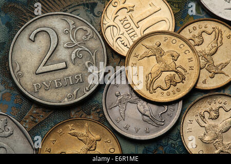 Coins of Russia. Saint George killing the Dragon depicted in the Russian kopek coins and the Russian two rouble - Stock Photo