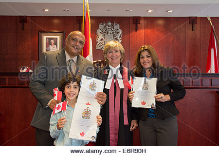 Toronto, Canada, A Hispanic family becomes Canadian citizens. Canadian nationality law determines who is granted - Stock Photo