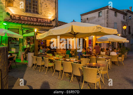 Outdoor restaurant in the old fortified citadel of Carcassonne, Languedoc-Roussillon, France - Stock Photo