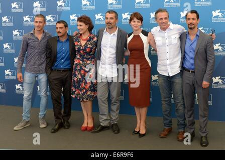 Venice. 29th Aug, 2014. Director Francesco Munzi (C) and cast members Giuseppe Fumo, Marco Leonardi, Anna Ferruzzo, - Stock Photo