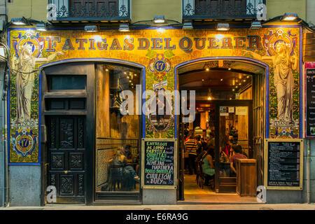 Night exterior view of a bar restaurant in Calle de la Cruz, Madrid, Comunidad de Madrid, Spain - Stock Photo
