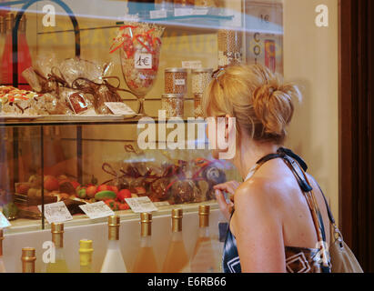 An attractive young blonde female tourist in Venice - Stock Photo