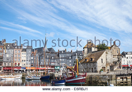 The old pier and waterfront of Honfleur and 18th century  la Lieutenance (The Lieutenancy) former home of  Governor - Stock Photo