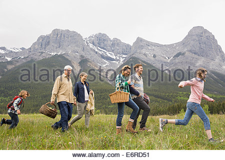 Family having picnic in rural field - Stock Photo