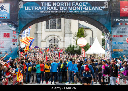 Chamonix, Mont Blanc, France. 29th Aug, 2014. Chamonix Mont Blanc, France. 29th Aug, 2014. Runners lift their batons in the air before the start of the UTMB Ultra Marathon trail race. The UTMB started in the rain from Chamonix Mont Blanc, France at 17.30 on 29-8-2014. The race takes the runners through 3 alpine countries (France, Switzerland and Italy), over many high mountain passes for a total of 163km of running and 9600m of height gain total while circumnavigating the Mont Blanc massif. The race is conducted in semi-autonomy with only a few stops for food and water. It is run for 2 nights