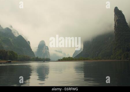 Misty karst hills along the Li River in Guangxi, China - Stock Photo