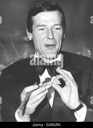 Jan 18, 1975 - Munich, Germany - Sir Roger George Moore, KBE (born 14 October 1927) is an English actor. He is perhaps - Stock Photo