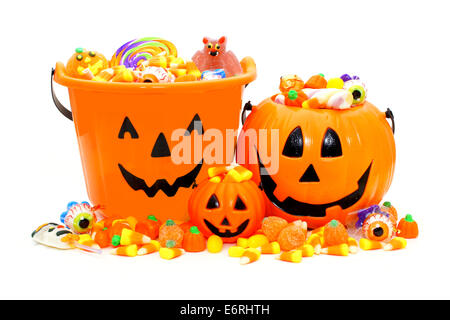 Group of Halloween Jack o Lantern candy holders and candies - Stock Photo