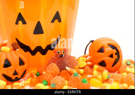 Halloween candy and Jack o Lantern holders close up - Stock Photo