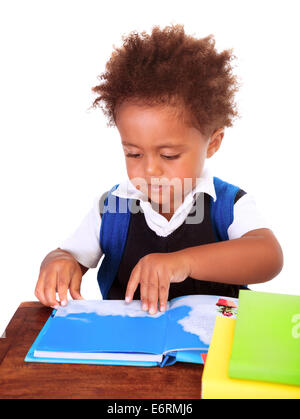Portrait of sweet little black boy reading books isolated on white background, preparation to go to first class, - Stock Photo