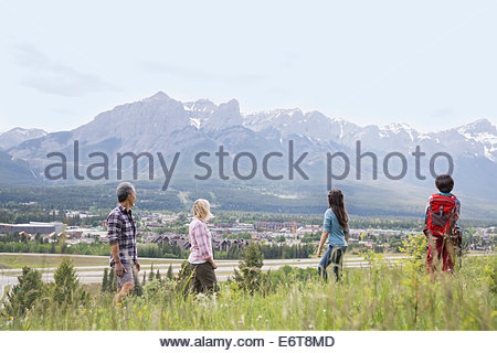 Family overlooking view from rural hillside - Stock Photo