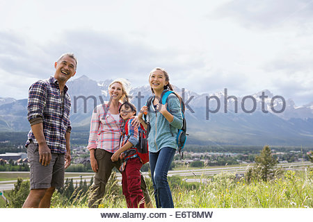Family talking on rural hillside - Stock Photo