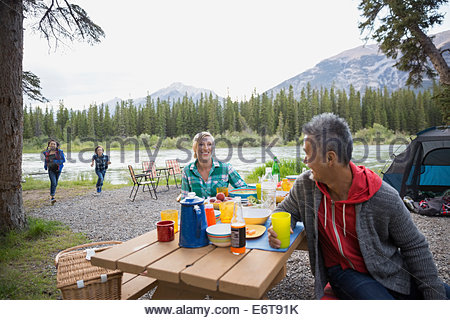Family relaxing together at campsite - Stock Photo
