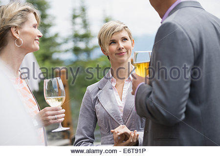 Business people talking at networking event - Stock Photo