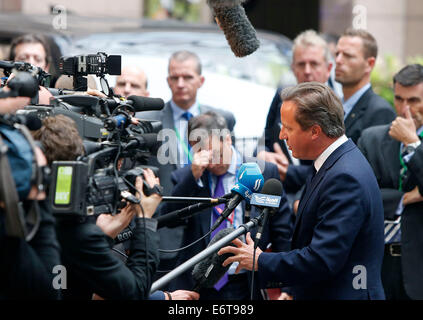 Brussels, Belgium. 30th Aug, 2014. British Prime Minister David Cameron talks to the media while arriving at the European Council headquarters ahead of the European Union (EU) special summit in Brussels, Belgium, August 30, 2014. The support for Ukraine and further sanctions against Russia are expected to top the agenda of the special summit on Saturday. Credit:  Zhou Lei/Xinhua/Alamy Live News Stock Photo