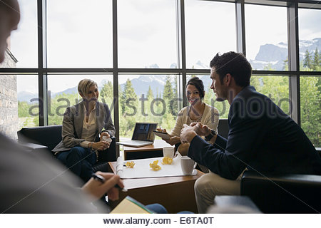 Business people meeting in office lobby - Stock Photo