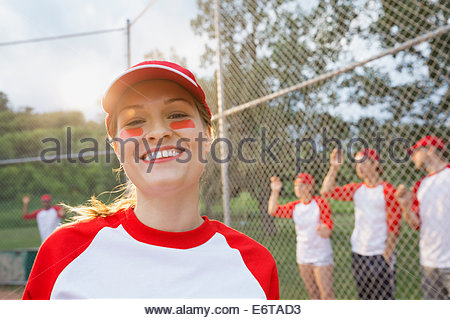 Baseball player smiling on field - Stock Photo