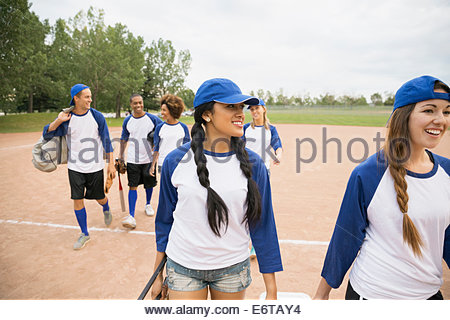 Baseball team walking together on field - Stock Photo