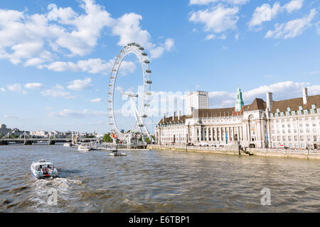The London Eye and River Thames in London on a summer day - Stock Photo