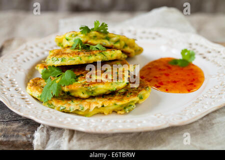 Courgette pancakes with chili sauce - Stock Photo