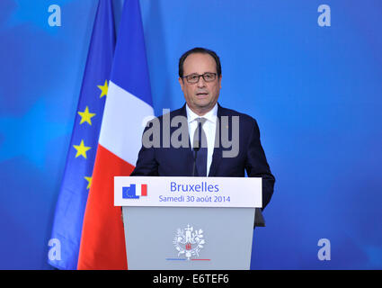 Brussels, Belgium. 30th Aug, 2014. French President Francois Hollande holds a press conference after a special EU summit at the EU Council headquarters in Brussels, Belgium, Aug. 30, 2014. Credit:  Ye Pingfan/Xinhua/Alamy Live News Stock Photo