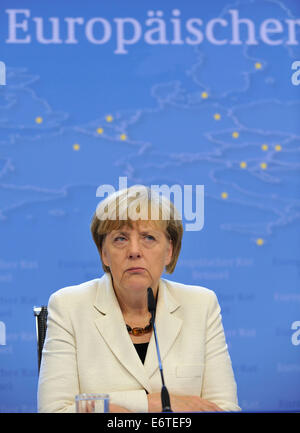 Brussels, Belgium. 30th Aug, 2014. German Chancellor Angela Merkel holds a press conference after a special EU summit at the EU Council headquarters in Brussels, Belgium, Aug. 30, 2014. Credit:  Ye Pingfan/Xinhua/Alamy Live News Stock Photo