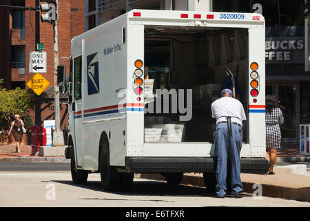 Mailman sorting mail in US Postal Service delivery truck - Washington, DC USA - Stock Photo