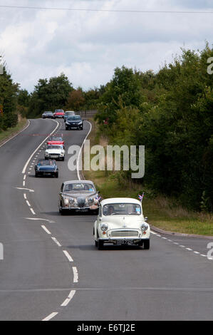 A convoy of cars in the Coventry Festival of Motoring Historic Vehicle Run. - Stock Photo