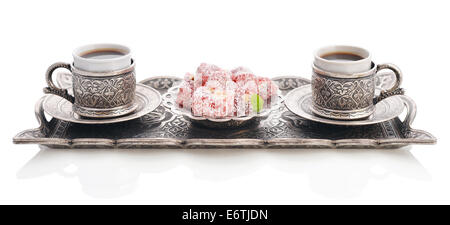Cup of coffee with turkish delight  and metal oriental tray isolated on white background - Stock Photo