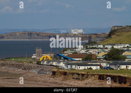 Caravan Park with Hinkley Point Nuclear Power Station in background. Bristol Channel. Somerset. UK - Stock Photo