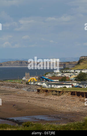 Caravan Park with Hinkley Point power station in background. Bristol Channel. Somerset. UK - Stock Photo