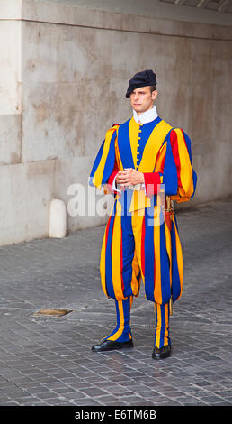 VATICAN CITY, VATICAN - AUGUST 1: Famous Swiss Guard surveil basilica entrance on August 1, 2014 in Vatican. The - Stock Photo
