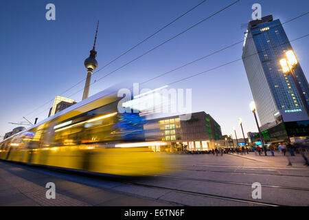 View of Alexanderplatz at night with  tram in Mitte Berlin Germany - Stock Photo