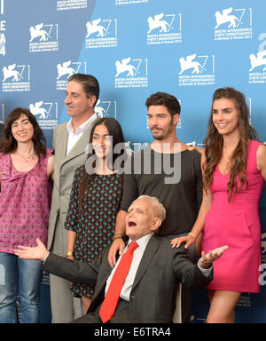 Venice, Lido of Venice. 31st Aug, 2014. Writer Mardik Martin (front) and actor Tahar Rahim (2nd R) and other cast - Stock Photo