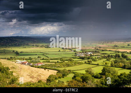 View of the Somerset levels from Glastonbury Tor with a moody sky
