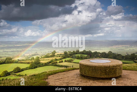 View from the top of Glastonbury Tor including toposcope with stormy sky and rainbow - Stock Photo