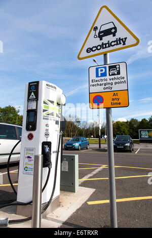 An Ecotricity electric vehicle charging point at Woolley Edge services on the M1 northbound at Wakefield, West Yorkshire, - Stock Photo