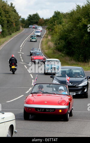 A Lotus Elan in a convoy of cars in the Coventry Festival of Motoring Historic Vehicle Run. - Stock Photo