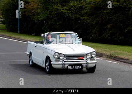 Triumph Vitesse car on the Fosse Way road, Warwickshire, UK - Stock Photo