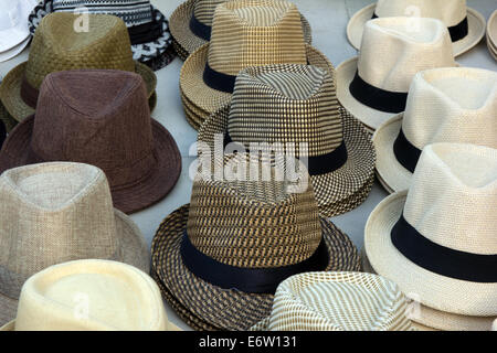 Hats on display at a street market in Panama City. - Stock Photo