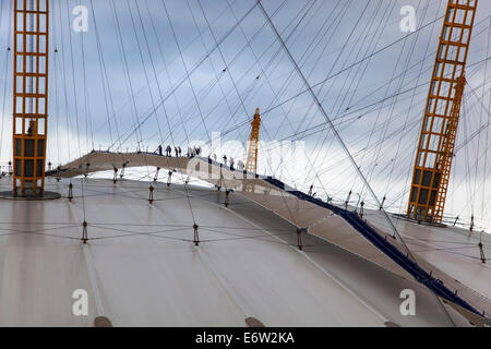 People climbing the O2 Arena dome roof, Greenwich, London - Stock Photo