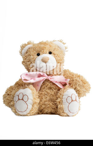 Closeup of a cute teddybear with a pink bow tie, isolated on white background - Stock Photo
