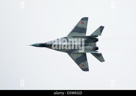 SLIAC, SLOVAKIA - AUGUST 30: flight of MiG-29AS during SIAF airshow in Sliac, Slovakia on August 30, 2014 Credit: - Stock Photo