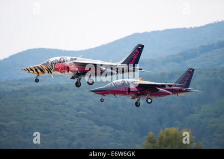 SLIAC, SLOVAKIA - AUGUST 30: Flight of Red Bull Alpha Jet team during SIAF airshow in Sliac, Slovakia on August - Stock Photo