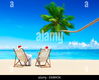 A Couple Relaxing in a Beach on a Sunny Day - Stock Photo