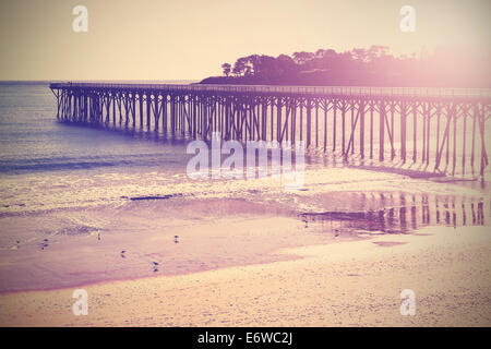 Vintage wood bridge at beach sunset, California, USA. - Stock Photo