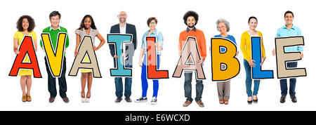 Group of People Standing Holding Available Letter - Stock Photo
